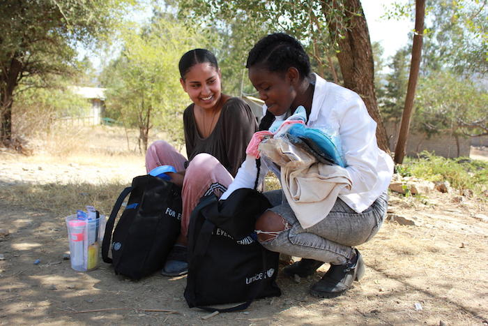 Eighteen-year-old Feven, left, and 20-year-old Senait, both uprooted by conflict in the Tigray region of Ethiopia, receive UNICEF dignity kits containing emergency supplies on Jan. 15, 2021.