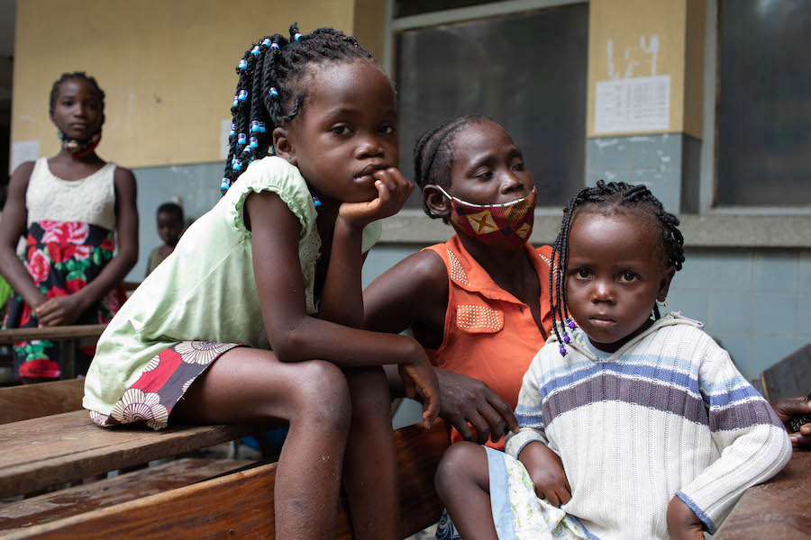 Over 600 of those displaced by Cyclone Eloise — including Joana Babasse, center, and her children, Amilia, 7, left, and Anguista, 4 — have taken shelter at the Samora Machel school in Beira, where they are sleeping in classrooms.