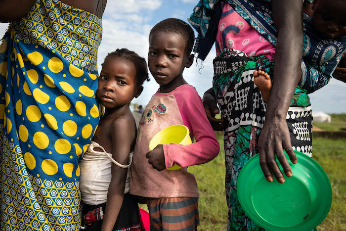 Outside the city of Beira, Mozambique, children queue for food at a UNICEF-supported relocation center sheltering families displaced by Tropical Cyclone Eloise.