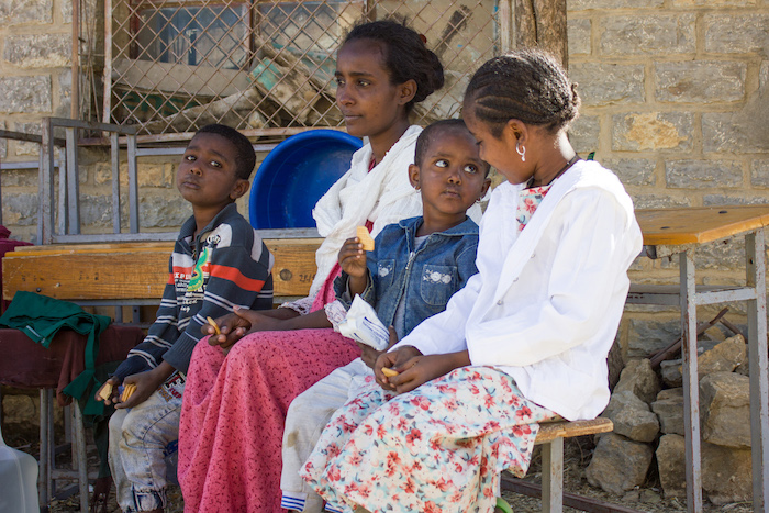 Tsega-brhan Mebrahtu, 27,andher three children — Milen, 3, with biscuit; Abel, 6, and Arsema, 10 — were displaced from Tigray's western zone and are staying in the town of Mekelle, where they are able to receive assistance from UNICEF, including nutriti