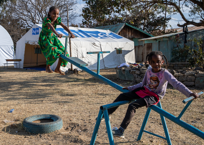 Two of the nearly 500 children who, uprooted by violence in the Tigray region, have come to stay at a primary school in Mekelle Town, now a displacement center supported by UNICEF.