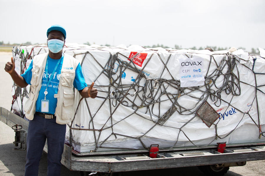 On February 26, 2021, (left to right) UNICEF supply officer Mohamadou Sy at the airport in Abidjan. Cote d'Ivoire received 504,000 COVID-19 vaccine doses from the COVAX Facility at the airport in Abidjan.