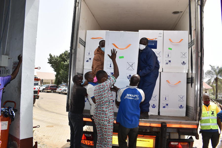 On March 2, 2021, workers offload a shipment containing 3.94 million doses of COVID-19 vaccines procured by the COVAX Facility at the Nnamdi Azikiwe International Airport in Abuja, Nigeria.