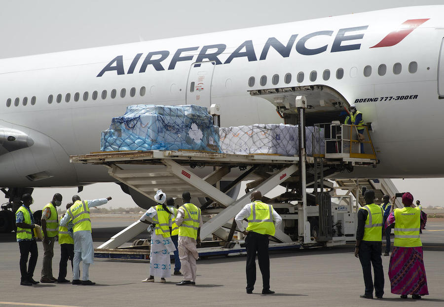 Mali's first batch of COVID-19 vaccines, procured by UNICEF through the COVAX Facility, arrives at Keita International Airport in Bamako on March 5, 2021.