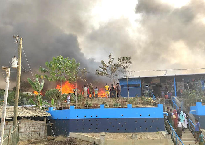 On March 22, 2021, a clinic supported by UNICEF and Partners in Health and Development is damaged by a massive fire in the Rohingya refugee camps in Cox's Bazar, Bangladesh.