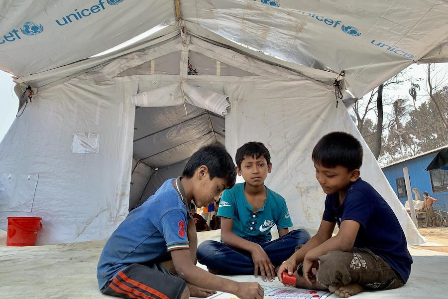 In March 2021, Rohingya refugee children play and study in a UNICEF Child-Friendly Space in Cox's Bazar, Bangladesh.