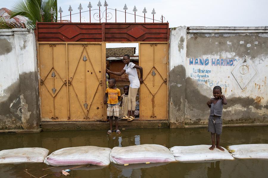 Residents negotiate the floodwaters in Gatumba, located near Bujumbura in Burundi.