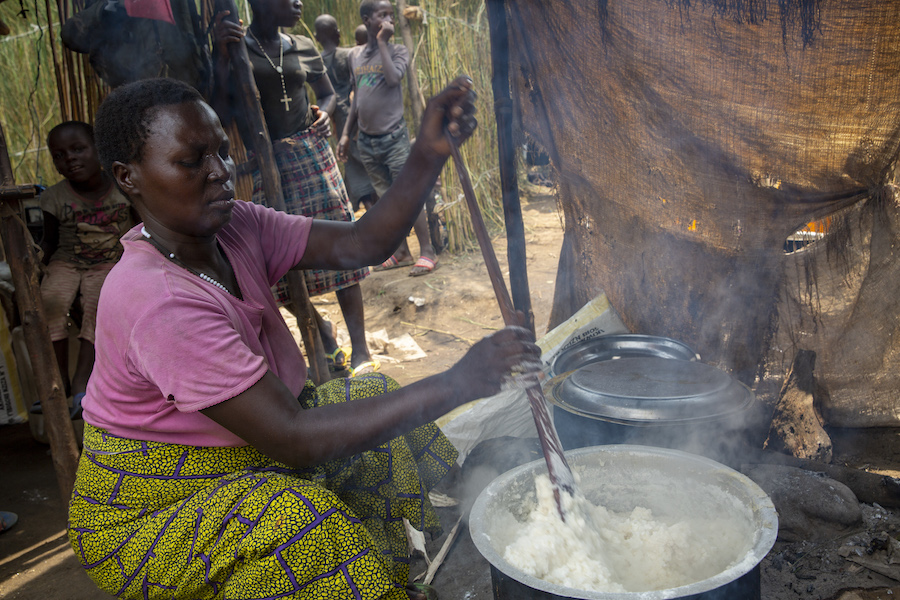 Odette Shurweryimana, a beneficiary of a micro-credit scheme funded by UNICEF and implemented by its partner Faith in Action, prepares a meal in her restaurant, located at a displacement camp in Gatumba, near Bujumbura in Burundi.