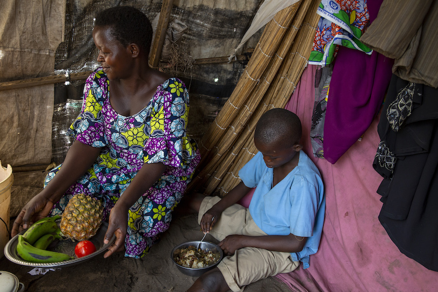 Jeannette, a seamstress, and her son have been staying at a displacement camp in Gatumba, Burundi since floodwaters destroyed their home.
