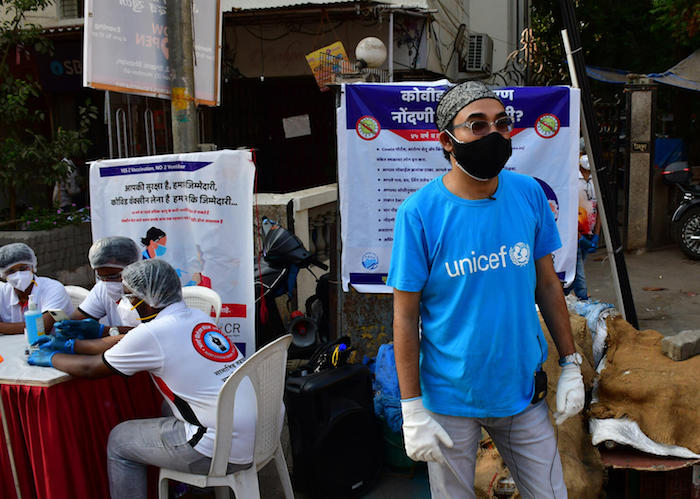 In a suburb of Mumbai on May 8, 2021, UNICEF Maharashtra WASH Specialist  Yusuf Kabir and Alert Citizen Forum activists register people to coordinate the delivery of COVID-19 vaccines in India.