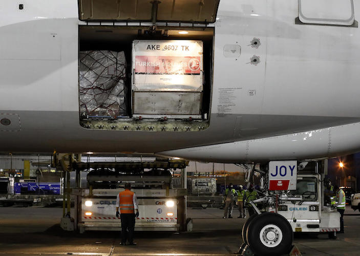 Ground staff prepare to unload the coronavirus (COVID-19) medical supplies sent by UNICEF, upon the arrival of a cargo plane at the Indira Gandhi International Airport in New Delhi on May 18, 2021.
