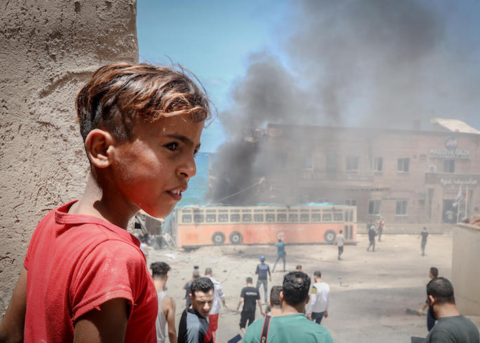 On May 17, 2021, a Palestinian child stands in front of the Gaza port, which was targeted by Israeli bombardment during the recent escalation.