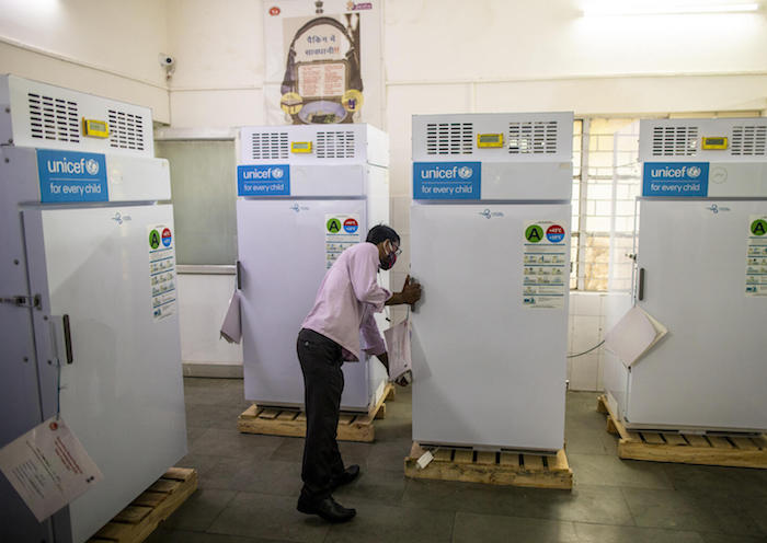 COVID-19 vaccines are stored in ice-lined refrigerators supplied by UNICEF at MMG Hospital in Ghaziabad, Uttar Pradesh, India.