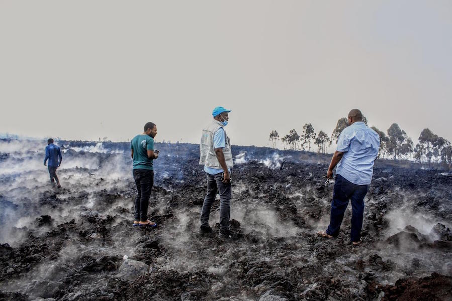 On May 23, 2021, UNICEF and Congolese Red Cross staff survey damaged caused by volcanic eruption in Goma, Democratic Republic of the Congo.