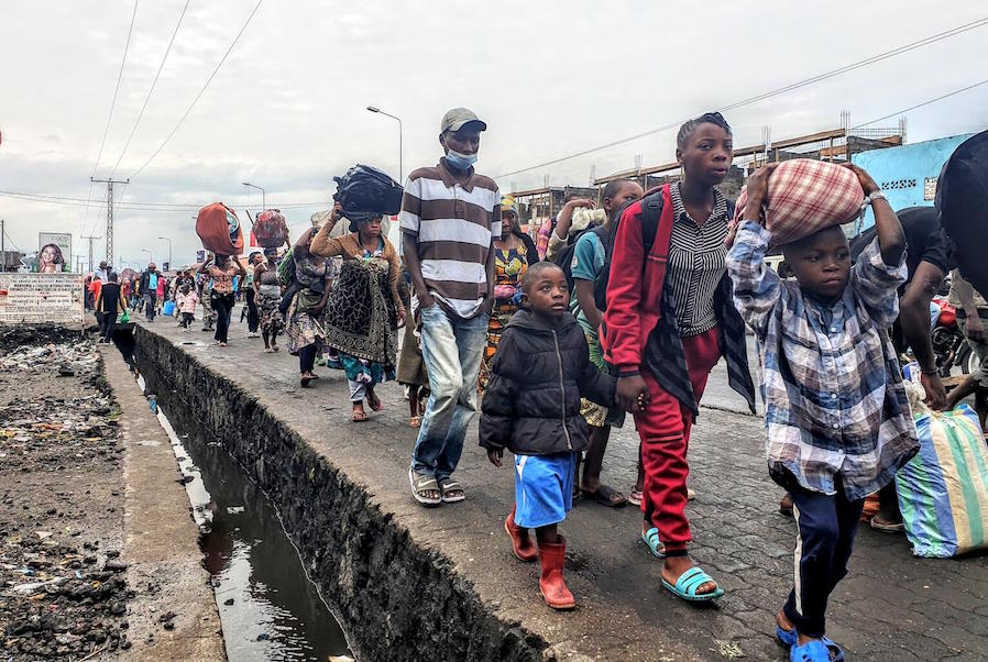 In the Democratic Republic of the Congo on May 27, 2021, residents of the city of Goma evacuate to Sake following warnings that Mount Nyiragongo might erupt a second time.