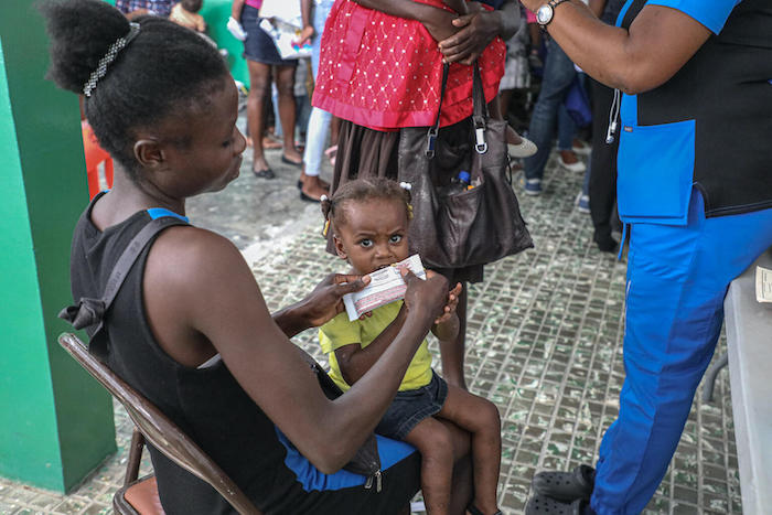 A malnourished child is given therapeutic food at a health facility in Saint-Jean-du-Sud, Haiti, on May 26, 2021.