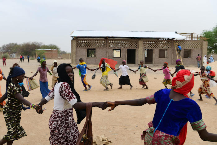 Students take a break in the playground outside a school in Gaoui, a suburb of Ndjamena, Chad.