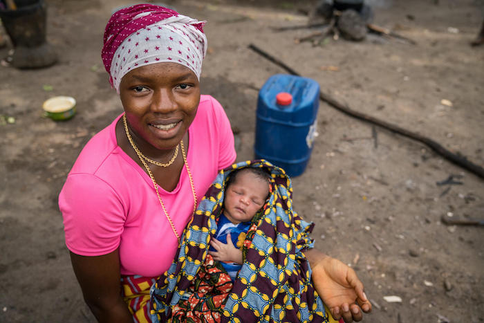 Makalai Kamara, holding her 3-day-old baby in Masiaka Community, Kambia District, Sierra Leone, received mental health and psychosocial support during her pregnancy through a UNICEF-supported Caring for the Caregiver program.