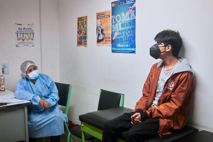 Psychiatrist Dr. Maria Saire meets with Andre (name changed), 14, at the Community Mental Health Center in Carabayllo, a district in the north of Lima, Peru.