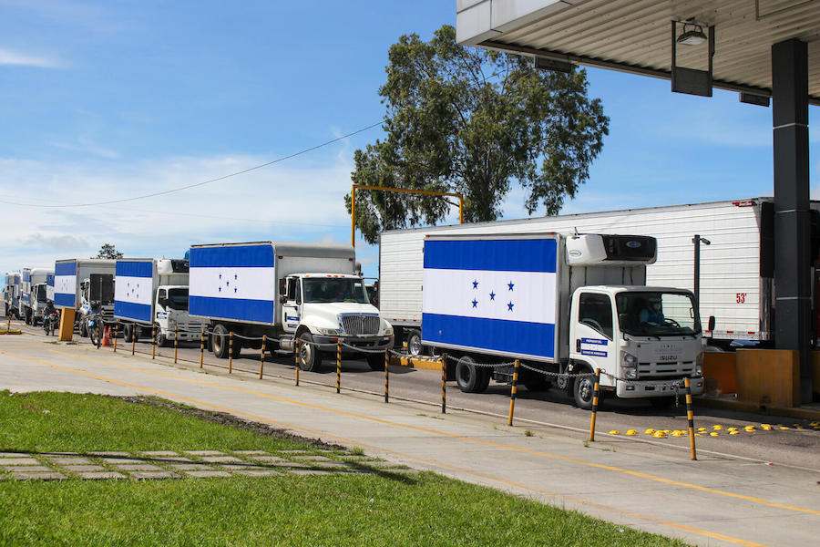 Refrigerated trucks on the road from Tegucigalpa to San Pedro Sula, in Honduras, to transport 1.5 million doses of COVID-19 vaccines donated by United States Government to Honduras via COVAX's dose-sharing mechanism on June 27, 2021..