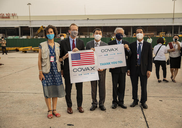 UNICEF Vietnam Deputy Representative Lesley Miller, far left, and fellow officials greeted the arrival of COVID-19 vaccine doses donated by the U.S. Government in Hanoi on July 25, 2021.