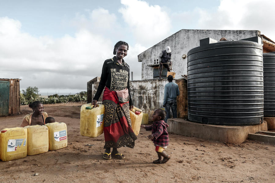 Masy, 35, collects water at a UNICEF-supported distribution pointin Maroalopoty, Ambovombe commune, Androy Region.