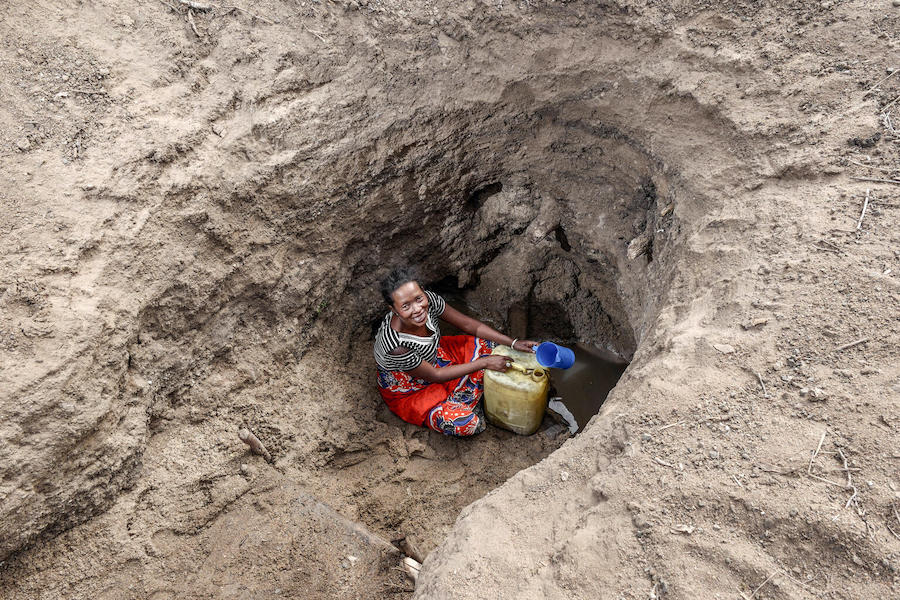 A woman in the Anosy region of southern Madagascar fetches water from an underground source.