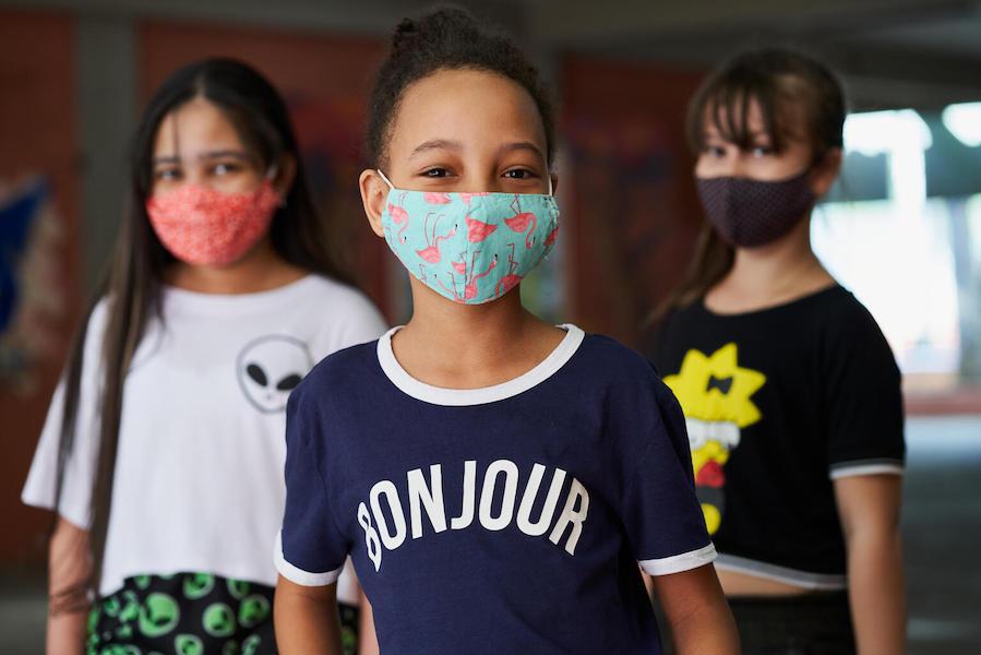 Three 10-year-old students – Maria Eduarda, Jaqueline and Estela –  are in the school courtyard at Brigadeiro Gavião Peixoto State School, in São Paulo, Brazil.