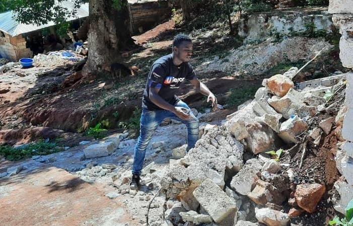 On August 14, 2021, Wadlet Merant, U-reporter from Peslet, moves earthquake rubble in Peslet, Haiti.