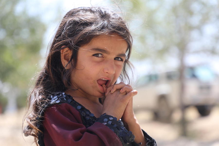 A girl stands at the Peer Mohammad Karkar high-school where more than 400 families from Kunduz, Sar-e Pol and Takhar provinces have taken shelter.