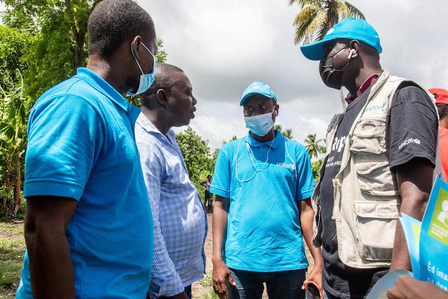 On August 18, 2021 UNICEF staff talk to the Deputy Mayor of the municipality of Torbeck before the distribution of emergency supplies in Valere, a village in the Torbeck commune of the Les Cayes Arrondissement, in Haiti's Sud Department.