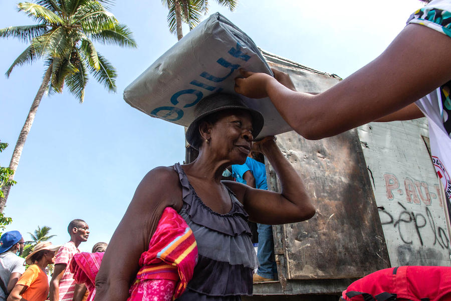 On August 18, 2021 in Valere, a village in Haiti's Sud Department, UNICEF workers distribute emergency supplies to families affected by Haiti's August 14, 2021 earthquake.