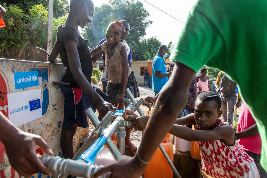 On August 18, 2021, in Marceline, near Haiti's Camp Perrin district, children and their families access clean and safe water at one of the four water stations supported by UNICEF in Les Cayes, Haiti.