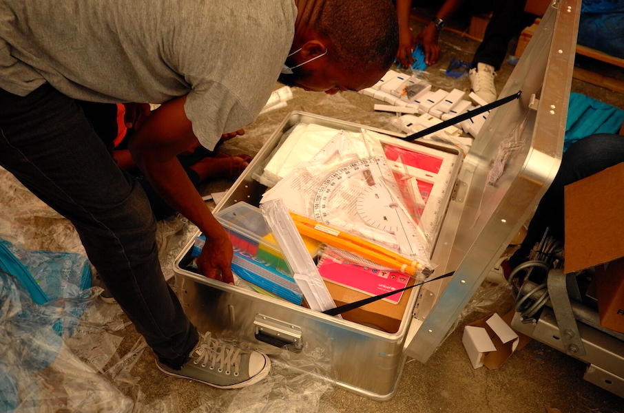 In October 2021, UNICEF staff prepare School in a Box kits for teachers in Haiti's southwest, where about 70 percent of schools remain damaged or destroyed by the August 14, 2021 earthquake.