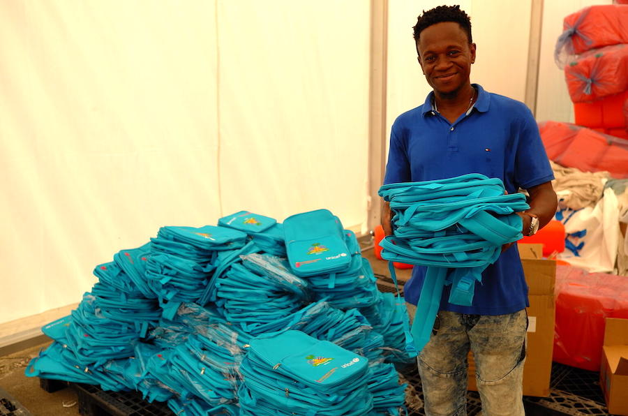 UNICEF staff in Les Cayes, Haiti prepare backpacks filled with school supplies for distribution to students affected by Haiti's August 14, 2021 earthquake.