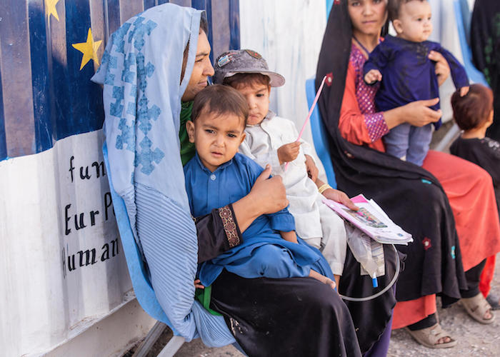 A mother and her children wait for their turn for a health and nutrition screening at a UNICEF- and WFP-supported Mobile Health Team clinic at Sabz-e-Shark IDP settlement in Herat, Afghanistan on September 29, 2021.
