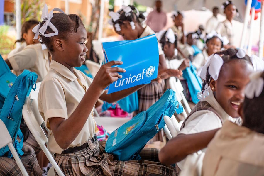 A student opens her schoolbag on the first day of the school in Les Cayes, Haiti on October 4, 2021.