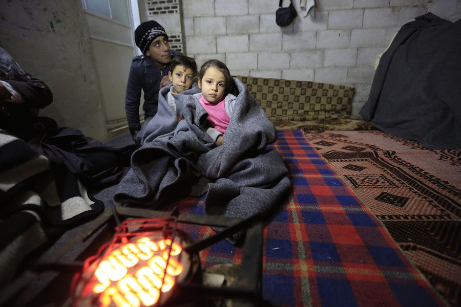 #SyriaCrisis Ashraf, 15, with his brother and sister in the infroal settlement of Al-Khalidia Al-Khamisa in Homs, Syria. UNICEF is targeting 1 million Syrian children with winter supplies during 2015/2016.
