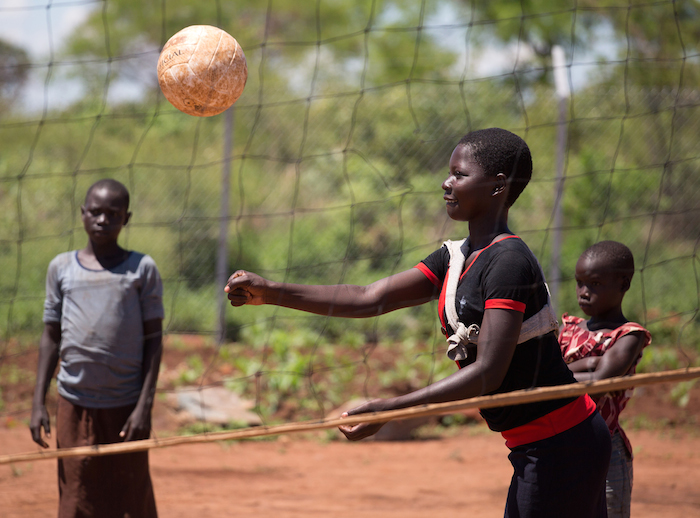 Girls play volleyball at a UNICEF-supported Child-Friendly Space in the Bidi Bidi settlement in Uganda for refugees from South Sudan.