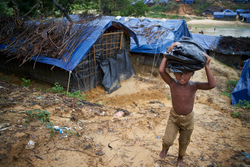 Here, a little girl, one of the hundreds of thousands of Rohingya refugees in Bangladesh, is bringing a tarp back to her family to help repair their damaged shelter. UNICEF Inspired Gifts tarps help protect families and their children after natural disasters strike. Shop UNICEF Inspired Gifts