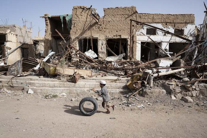 A young Yemeni boy plays alongside buildings damaged by fighting in Saada Governorate. This area was once home to Saada's oldest market, where thousands of people sold vegetables, spices and fabrics from storefronts and street stalls. © UNICEF/UN073958/Cl