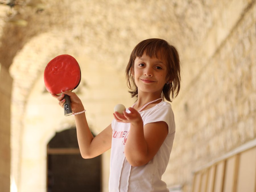 Bayan, 11, has loved playing ping pong for as long as she can remember. Though she and her family were forced to flee their home in Aleppo, Syria, she refuses to let the war or her disabled right arm get in the way of her dreams. Thanks to cash assistance