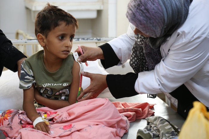 Cholera is life-threatening for young children, especially for those who are malnourished. Here, a child who contracted the deadly disease during Yemen's massive 2017 outbreak has his arm measured by a health worker at the Alsadaqah Hospital in Aden to ch