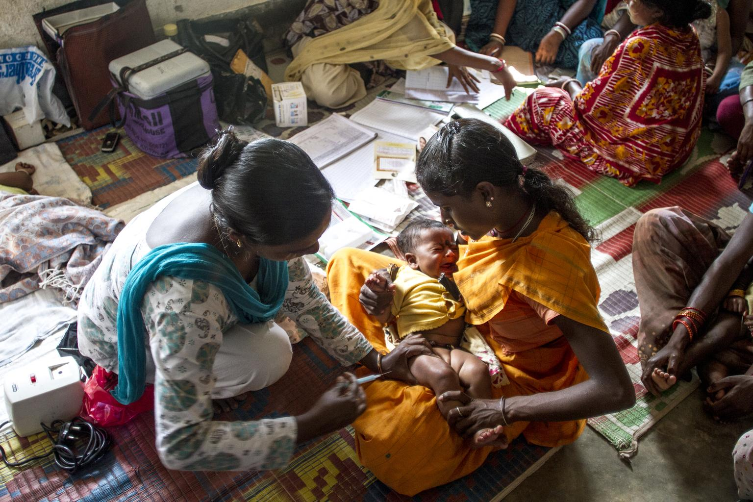 A child is vaccinated against tetanus at a health center in Nmakum, India.