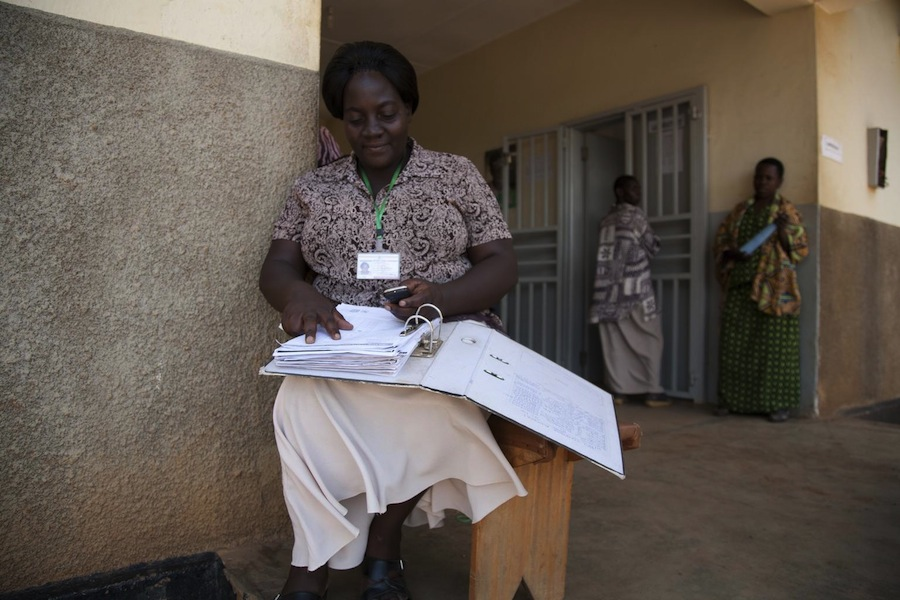 A nursing officer in Uganda uses the UNICEF mTrac system to collect and send public health data to district headquarters.