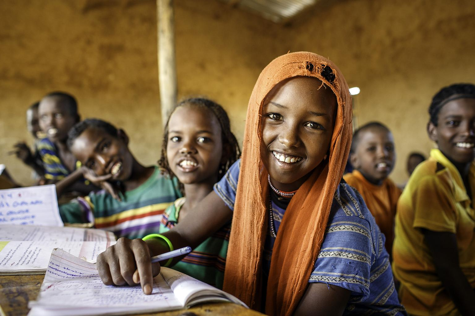 Esa Ali Mohammad, 11, 4th grader at a primary school,  studies with her classmates in Afar region of Ethiopia