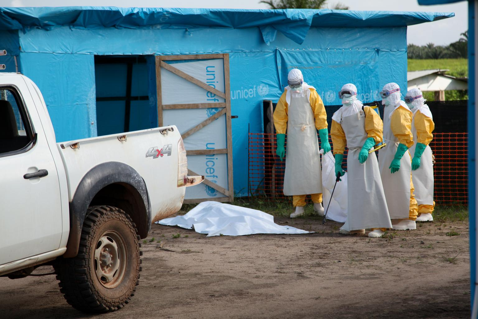 In July 2014 in Liberia, health workers, wearing head-to-toe protective gear, prepare for work, outside an isolation unit in Foya District, Lofa County.