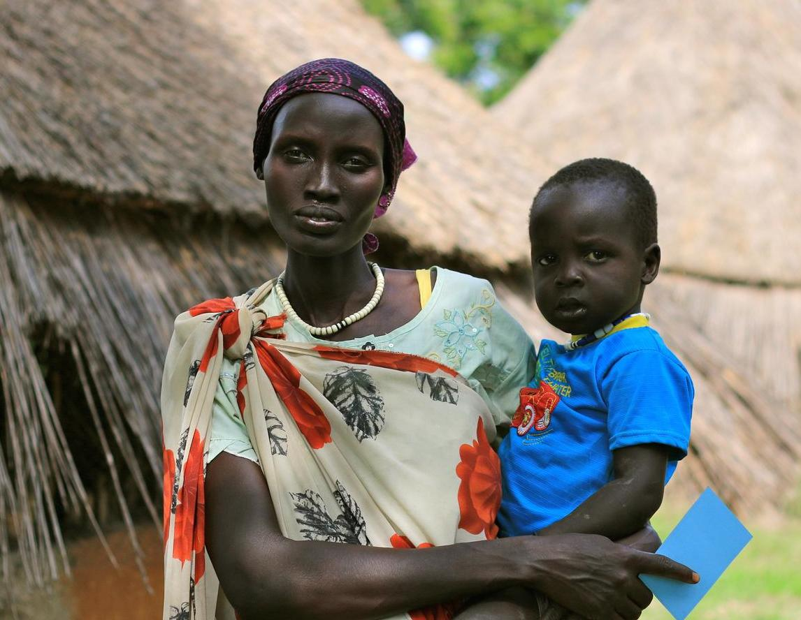 Nyalyauk Nyok, holding 3-year-old Gatluak Wiyual in Kiech Kon , South Sudan, where UNICEF and partners are assisting people affected by the conflict.