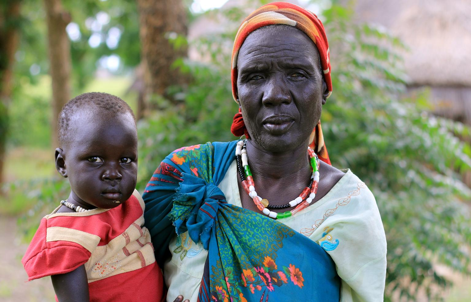 Nyatay Gatkuoth holds Nyahuach Ter, her 3-year-old, in Kiech , South Sudan, where UNICEF and partners are assisting people affected by the conflict.