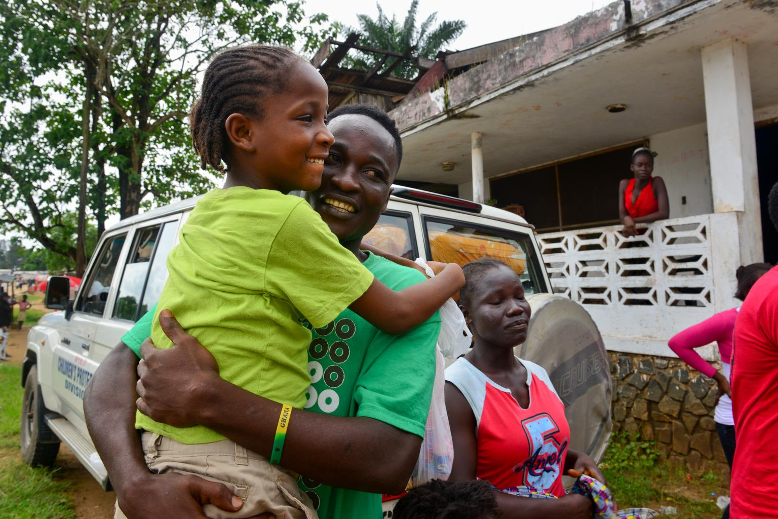 Nine-year-old Mercy, an Ebola orphan in Monrovia, Liberia, is reunited with her older brother outside a UNICEF-supported interim care center.